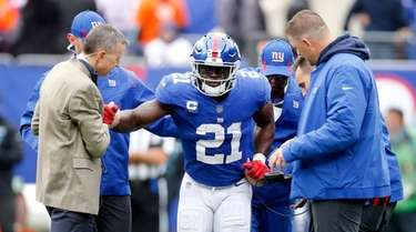 Jabrill Peppers #21 of the Giants is helped