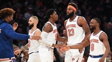 Knicks guard RJ Barrett, center Mitchell Robinson and