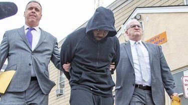 Roy Christmas leaves Nassau police headquarters in Mineola