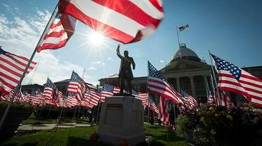 American flags embellish the front lawn of the