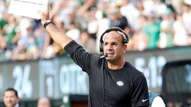 Robert Saleh of the Jets looks on in