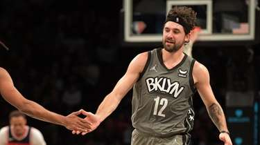 Joe Harris of the Nets is congratulated by