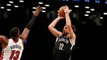 Joe Harris #12 of the Nets attempts a