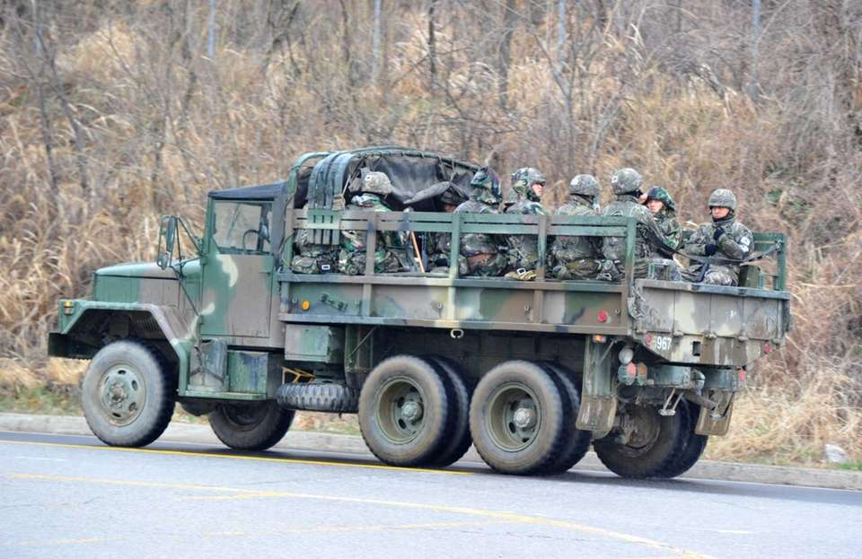A truck with South Korean army soliders moves