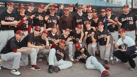 The Clarke baseball team celebrates coach Tom Abruscato's