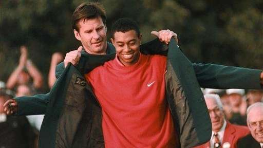 Masters champion Tiger Woods receives his green jacket