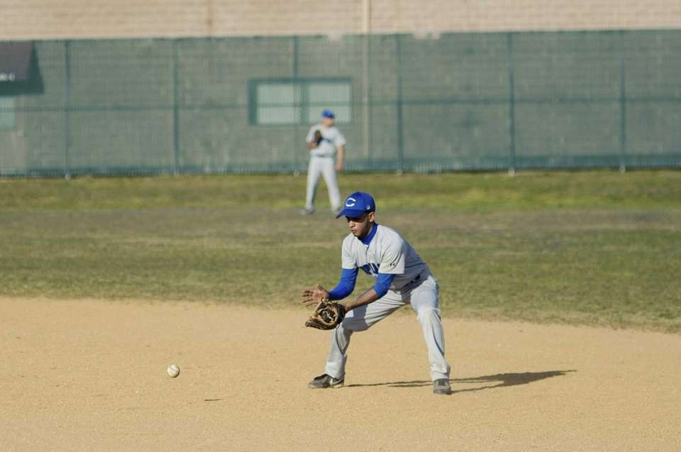 Copiague shortstop, Junior Carty fields a ground ball