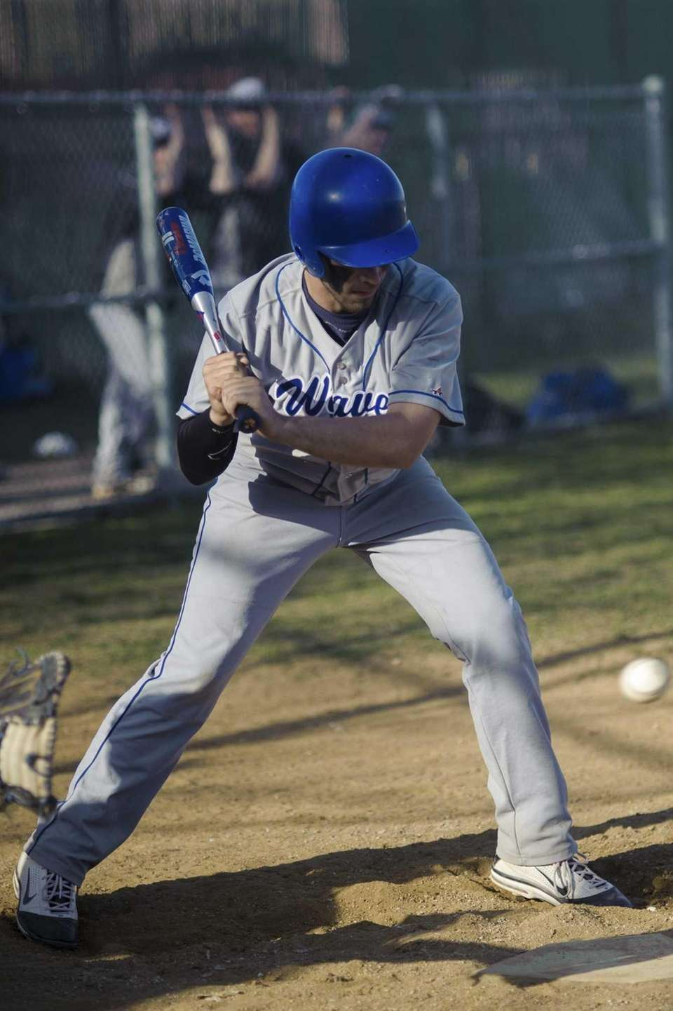 Riverhead's Josh Brewster follows a pitch by Copiague's