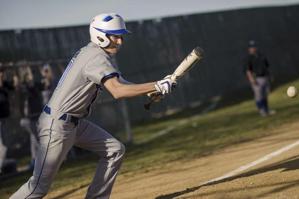Riverhead's Ken Simco squares to bunt on a