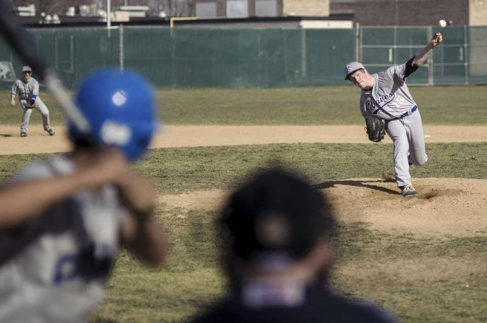 Riverhead pitcher Matt Crohan delivers to home plate