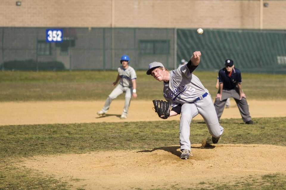 Riverhead pitcher Matt Crohan delivers a pitch during