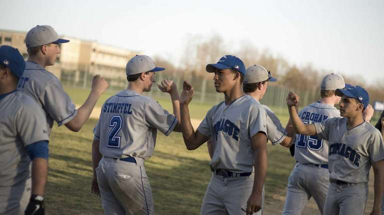 Riverhead players give one another high-fives during after