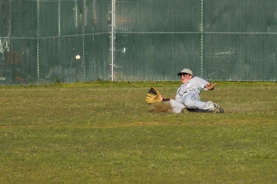 Riverhead's Ryan Gaffney slides in on a line