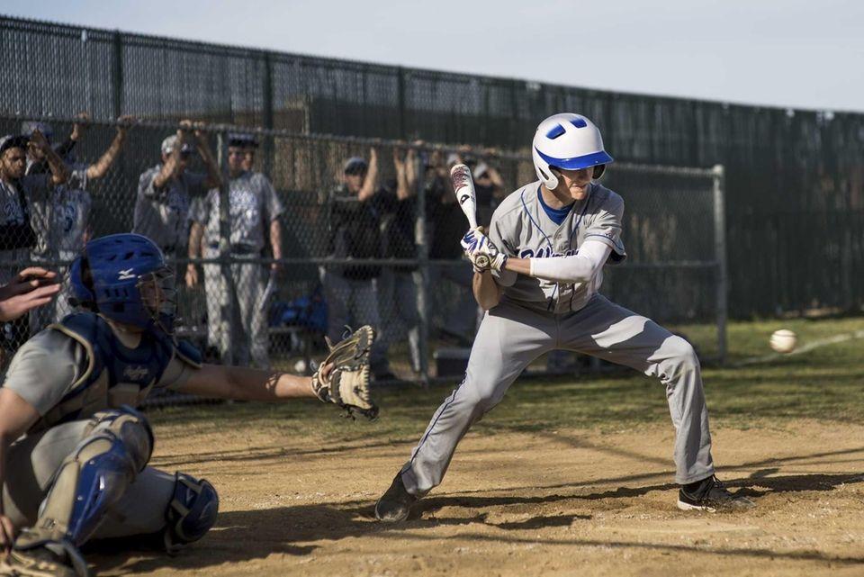Riverhead's Ken Simco follows a pitch thrown by