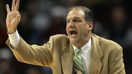 Niagara coach Joe Mihalich gives a play to