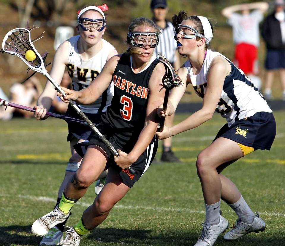 Babylon's Shelby Fredericks is double-teamed behind the goal