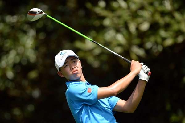 Tianlang Guan hits a shot during a practice