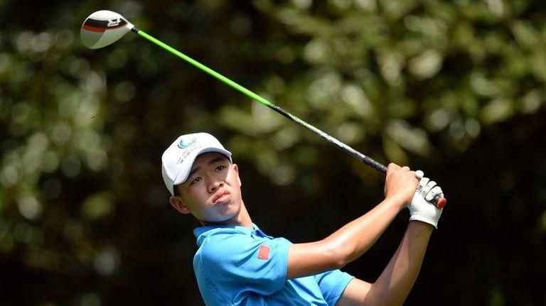 Tianlang Guan hits a shot during a practice