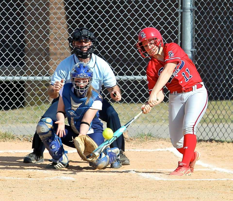 Smithtown East's MacKenzie Buckley drives the pitch to