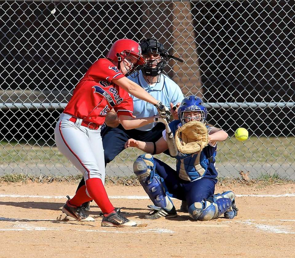 Smithtown East's Madison Provencher tries to connect on