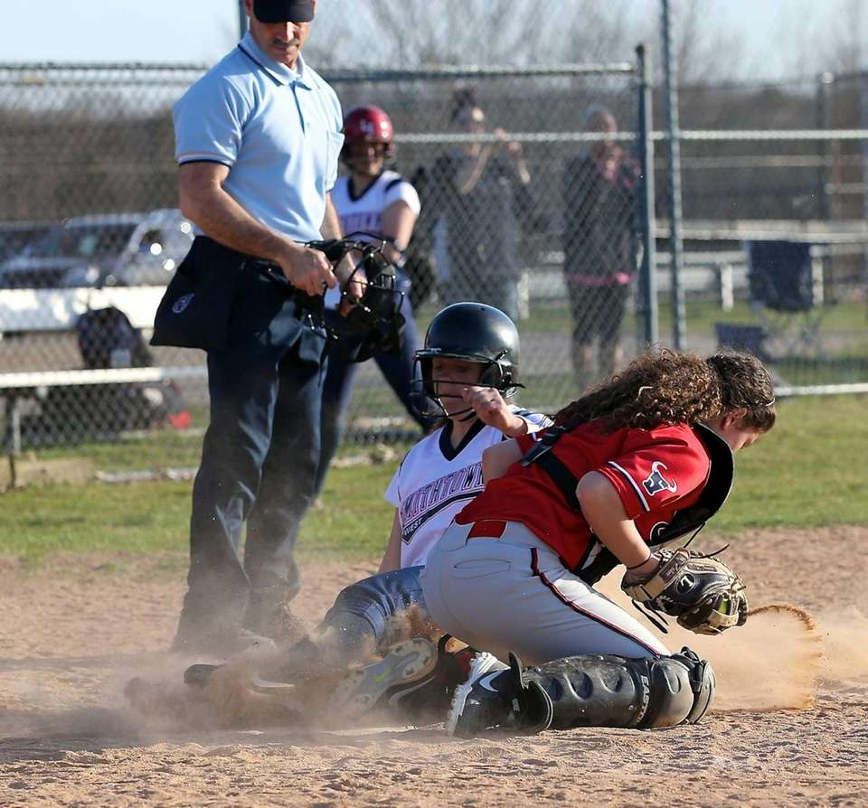 Smithtown East catcher Stefanie Aplin gets the out
