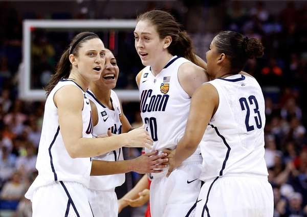 Breanna Stewart of the Connecticut Huskies celebrates with