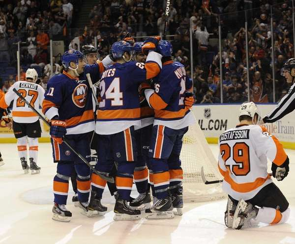 The Islanders celebrate a goal by John Tavares