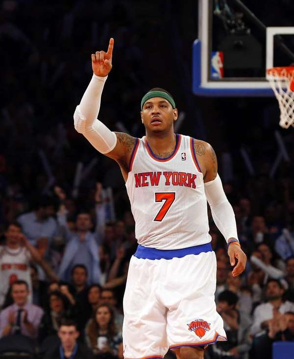 Carmelo Anthony of the Knicks celebrates after assisting