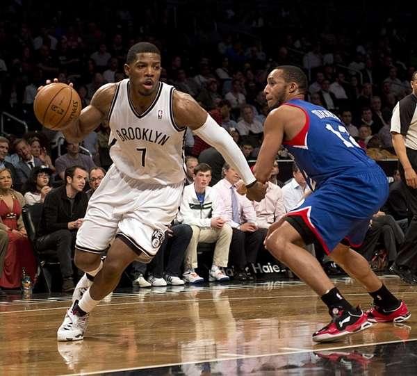 Nets' Joe Johnson drives the baseline against the
