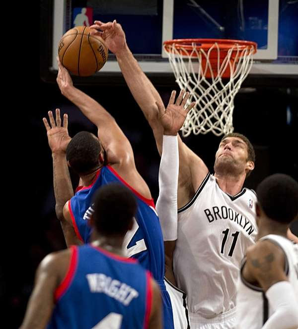 Nets' Brook Lopez blocks the shot of Philadelphia