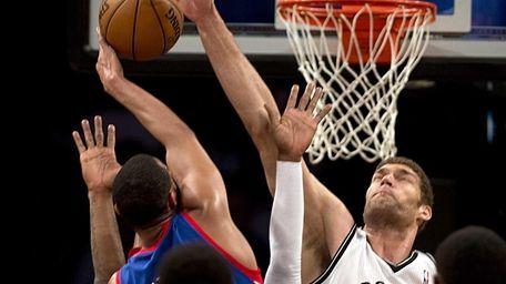 Nets' Brook Lopez blocks the shot of Philadelphia