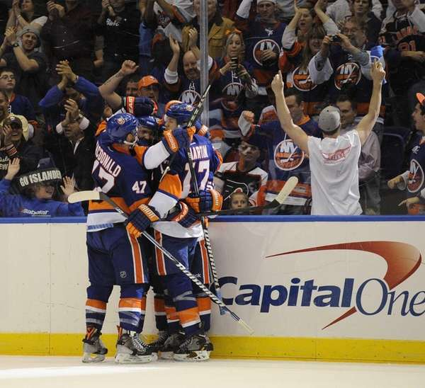 The Islanders celebrate a goal by Casey Cizikas