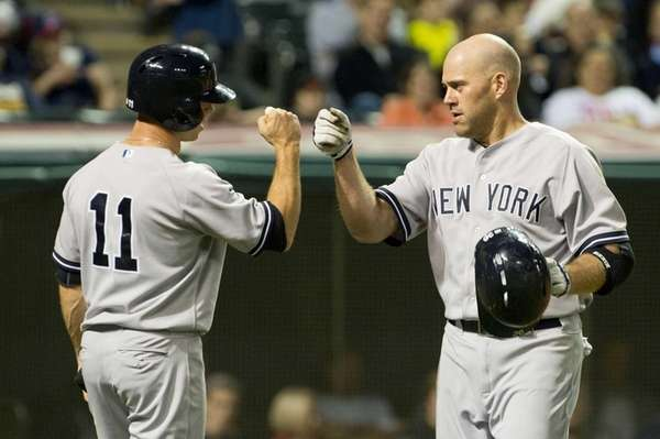 Brett Gardner celebrates with Kevin Youkilis of the