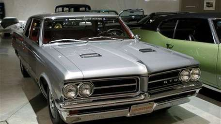 A 1964 Pontiac GTO is shown at the