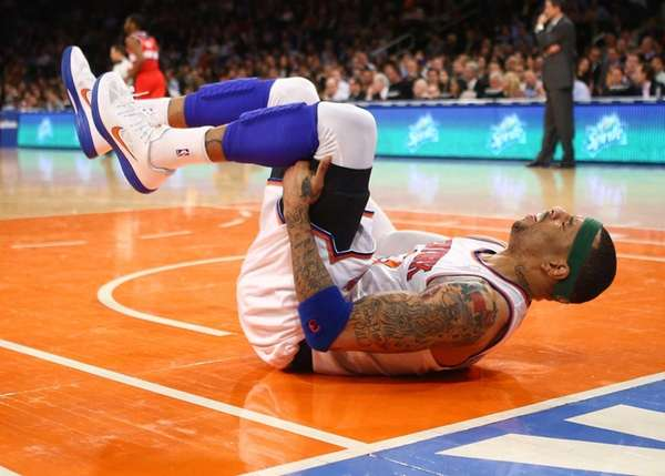 Kenyon Martin hurts his ankle during a game