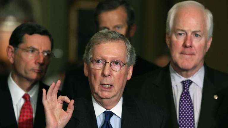 Senate Minority Leader Mitch McConnell speaks to the