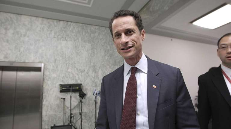 Anthony Weiner walks from his office to an