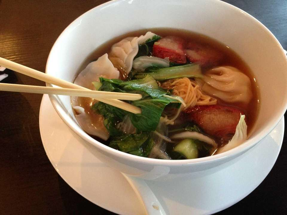 A hearty shrimp dumpling noodle soup at Tang