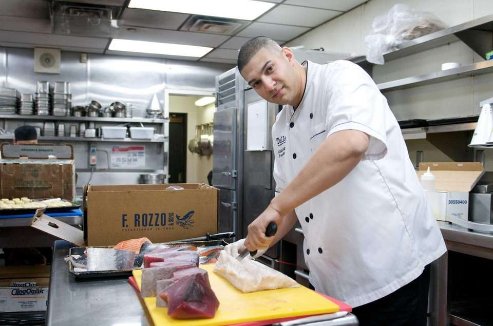 Executive chef Edward Villatoro prepares fresh fish for