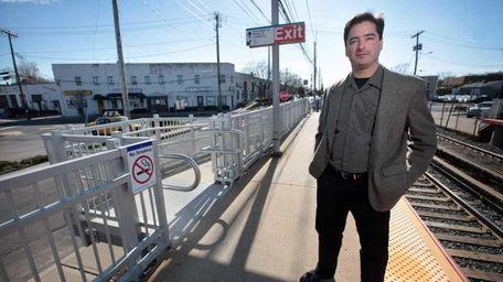 Farmingdale developer Anthony Bartone stands on the platform