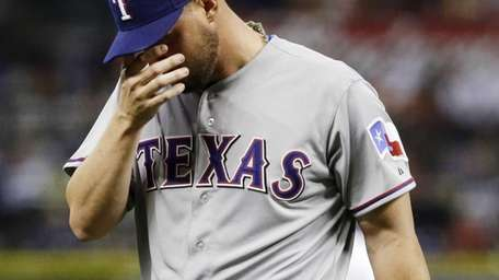 Texas Rangers pitcher Matt Harrison is replaced by