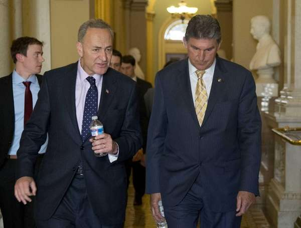 Sens. Chuck Schumer and Joe Manchin walk in