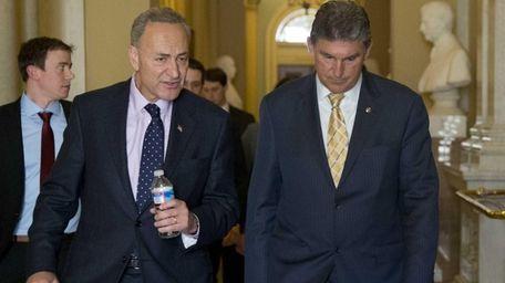 Sens. Chuck Schumer and Joe Manchin walk in