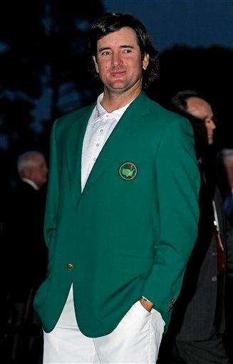 Bubba Watson stands in his green jacket after