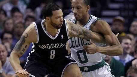Deron Williams tries to drive against Boston Celtics