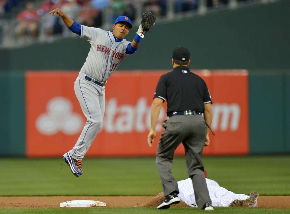 Ruben Tejada of the Mets jumps to catch