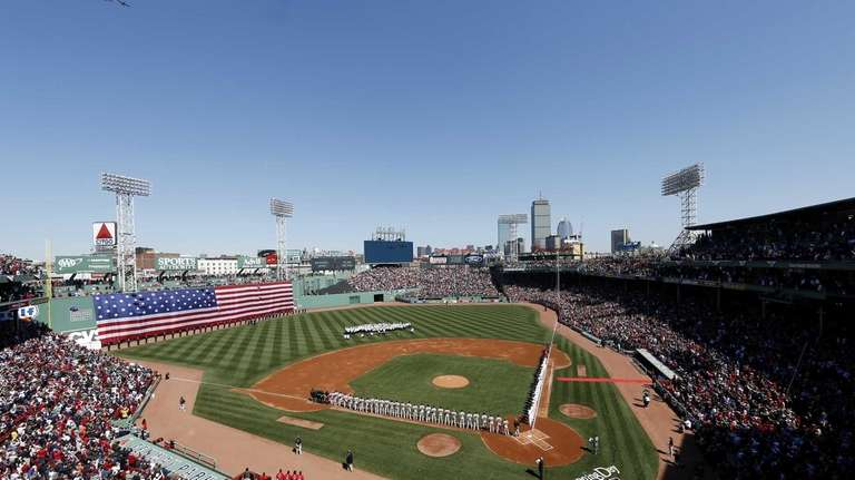 Two P-51's flyover Fenway Park during opening ceremonies