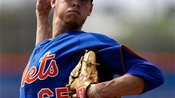 Zack Wheeler throws a live batting practice session