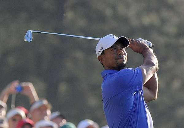 Tiger Woods hits a shot during a practice