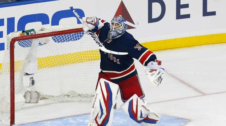 Henrik Lundqvist of the Rangers celebrates his game